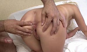 Irina prepares for an anal inspection