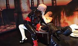 Bald chick licking her lesbian friend